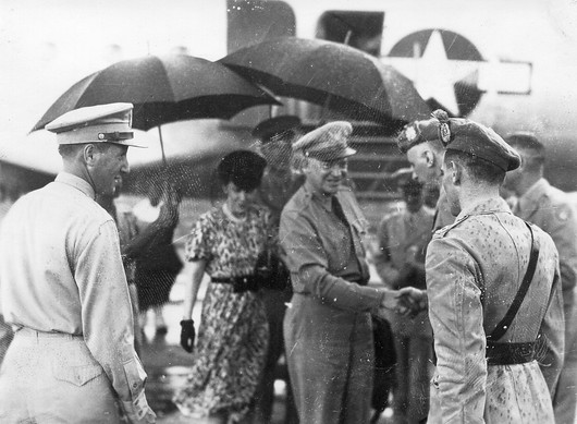 """General Dwight David """"Ike"""" and Mrs. Mamie Eisenhower lands at Atkinson Field (Guyana's first airport) near Georgetown, British Guiana. August 11, 1946."""